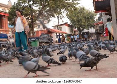 Katmandu, Nepal - Oct 10 2014: Durbar Square in Katmandu, Nepal is full of pigeons.