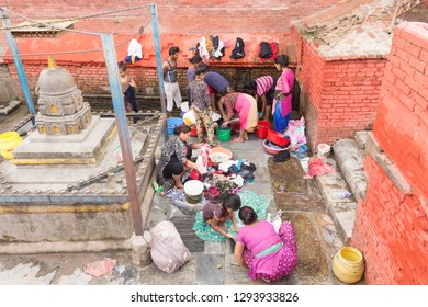 Katmandu / Nepal - September 3 2018: women and children washing clothes in old town Katmandu.