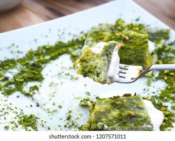 katmer dessert of Turkey Gaziantep region. Prepared with thin dough dessert with ice cream and green pistachio.