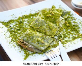 katmer dessert of Turkey Gaziantep region. Prepared with thin dough dessert with ice cream and green pistachio.