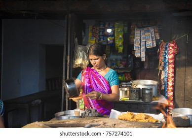 Katni / India 22 October 2017 Indian woman making morning tea on her street shop at Katni Madhya Pradesh India