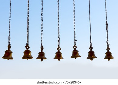 Katni / India 22 October 2017 Brass praying bells hanging on a temple  at Katni Madhya Pradesh India