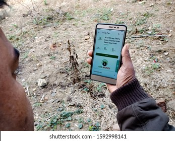 Katni, India - Dec 2019: Atd money salary loan application software displayed on mobile phone screen in holded hand mobile concept