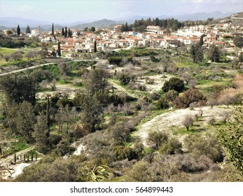 Kato Drys, south west of Larnaca, Cyprus. A pictorial view from surrounding hillside against pale blue sky