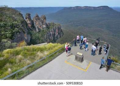 KATOOMBA, AUS - OCT 21 2016:Aerial view of people visiting at the Three Sister lookout at Jamison Valley in the Blue Mountains in New South Wales, Australia.