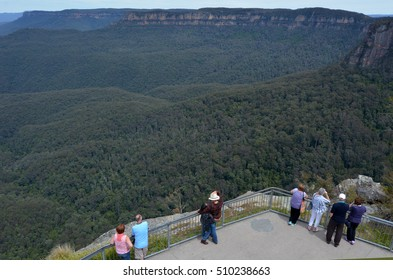KATOOMBA, AUS - OCT 21 2016:Aerial view of people looks at Jamison Valley from Echo Point lookout in Katoomba in the Blue Mountains in New South Wales, Australia.