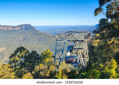 """Katoomba / Australia - May 26 2019: A Cable Car Operated by """"Scenic World"""" Rises From the Jamison Valley in the Beautiful Blue Mountains"""