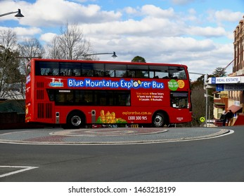 Katoomba, New South wales, Australia. July 2019. The Blue Mountains hop on hop off bus rounds the roundabout at the top of Katoomba Street in the Blue Mountains west of Sydney.
