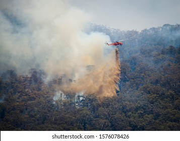 Katoomba, New South Wales / Australia - December 1st 2019: NSW Rural Fire Service drop water from a helicopter onto Ruined Castle Bush Fire in the Blue Mountains.