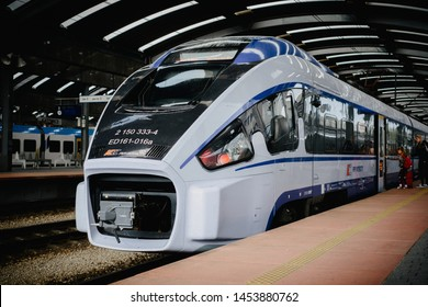 """Katowice, July 14 2019, Poland, railway station. Impuls Electric low-floor manufactured by """"PESA bydgoszcz"""" at the Katowice station in the colors Intercity PKP. Interurban train journey."""