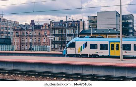 """Katowice, July 14 2019, Poland, railway station. Impuls Electric low-floor manufactured by """"PESA bydgoszcz"""" at the Katowice station in the colors of the railway """"Koleje Slaskie""""."""