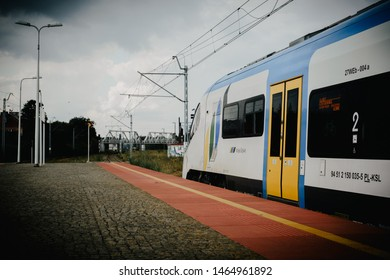 """Katowice, July 14 2019, Poland, railway station. Elf of the second generation Electric low-floor manufactured by """"PESA bydgoszcz"""" at the Katowice station in the colors of the railway """"Koleje Slaskie""""."""