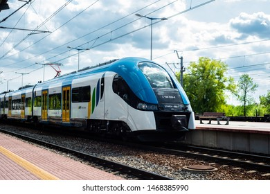 """Katowice, July 14 2019, Poland, railway station. Elf first generation Electric low-floor manufactured by """"PESA bydgoszcz"""" at the Katowice station in the colors of the railway """"Koleje Slaskie""""."""