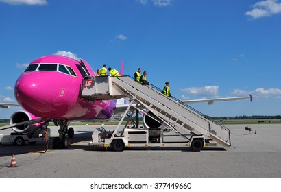 KATOWICE - JULY 2: Cabin crew staff leaving the Wizzair Airbus A320 after the landing on July 2, 2015 in Katowice Airport, Poland. Wizzair is one of the largest low-cost airlines.