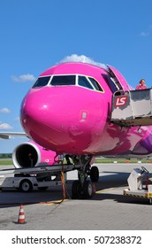 KATOWICE - JULY 2: Wizzair Airbus A320 is being prepared for the takeoff, crew is preparing the plane for flight on July 2, 2015 in Katowice Airport, Poland.