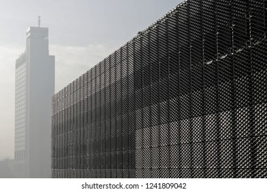 Katowice, Śląskie, Poland - 01/09/2016: the eastern wall of International Convention Center MCK, with the Altus Tower Office in the background.