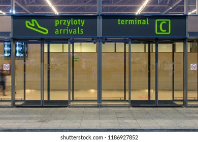 Katowice, Poland - 06/16/2018: Empty international airport entrance in Katowice, Poland. Travel and journey concept. Aviation and transportation concept. Terminal C door. Airport exterior.