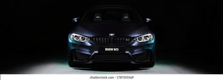 Katowice / Poland - 12/03/2016: The front of the BMW M3 30 Jahre Edition standing in a dark garage. This is a limited edition created to celebrate the 30th anniversary of the M3. 500 pcs only, 450 hp.