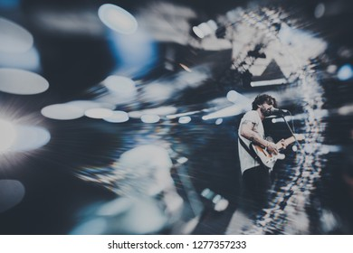 Katowice, Poland - 4-6 August 2017: Off Festival lensbaby effect: guitarist vocalist in the spotlight