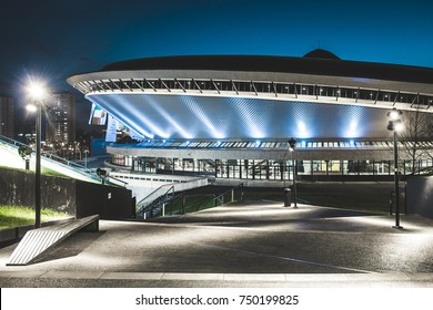 KATOWICE, POLAND - APRIL 22, 2016: The new public area situated on the grass-covered roof of the Congress Center building in Katowice, with Spodek event hall visible in the distance.