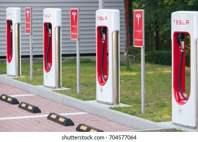 KATOWICE, POLAND - AUGUST 26, 2017: Tesla Supercharger station in Orlen Gas Station, Katowice. Tesla motors develops network of the charging stations across Europe and World