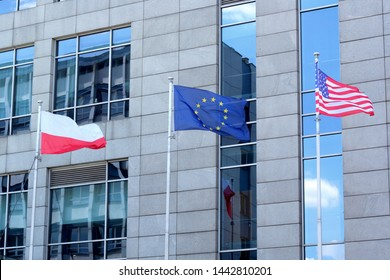 Katowice, Poland - July 4, 2019: Flags of Poland, European Union and the United States in front of a hotel.