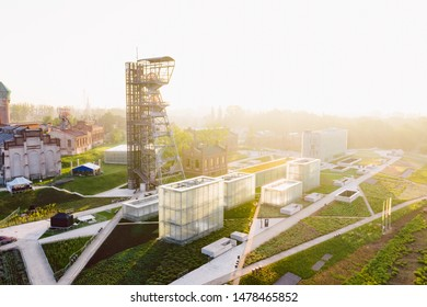 """KATOWICE, POLAND - JUNE 08, 2019: The modern buildings of Silesian Museum accompanied by a shaft of the former coal mine """"Katowice"""", now adapted as an observation tower."""