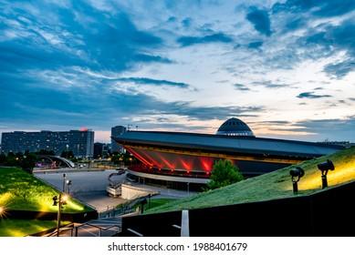 Katowice, Poland, June 2021: Spodek sports arena illuminated by evening lights, famous landmark of Katowice city and green roof of International Congress Centre