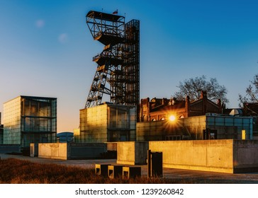 """KATOWICE, POLAND – NOVEMBER 17, 2018: The former coal mine """"Katowice"""", seat of the Silesian Museum at dusk. The complex combines old mining buildings and infrastructure with modern architecture."""