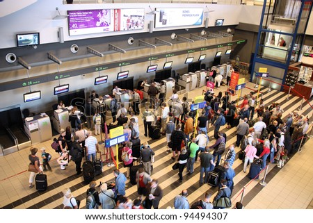 KATOWICE, POLAND - SEPTEMBER 1: Travelers wait for check-in on September 1, 2009 at Katowice Airport, Poland. With 2.366m passengers in 2010 it was the 3rd busiest airport in Poland.