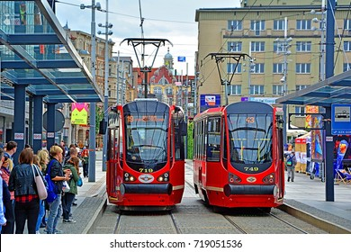 KATOWICE, POLAND - SEPTEMBER 13 - Modernized Konstal 105Na trams, belonging to Tramwaje Slaskie, on Rynek tramway stop in the centre of Katowice on September 13, 2017