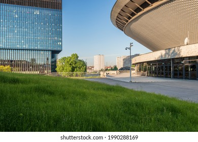 Katowice, Silesia, Poland; June 4, 2021: View on the Spodek Arena and office building KTW; city panorama in background