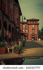 Katowice,Nikiszowiec, Silesia/ Poland - 06.15.2019: Square with people and decorated tenements in the old mining district of Katowice.