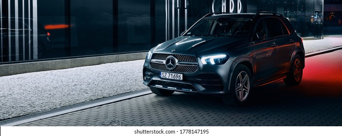 Katowice/Poland - 01.12.2020: Mercedes GLE parked next to a modern night-lit building