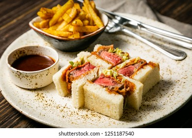 Katsu Sando - food trend japanese sandwich with pork and fries, copy space