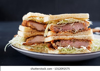 Katsu Sando - food trend japanese sandwich with breaded pork chop, cabbage and tonkatsu sauce. Japanese cuisine.