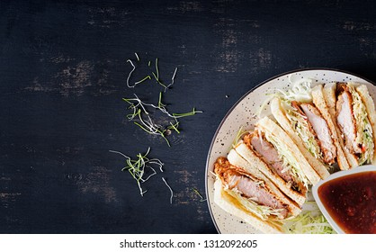 Katsu Sando - food trend japanese sandwich with breaded pork chop, cabbage and tonkatsu sauce. Japanese cuisine. Top view