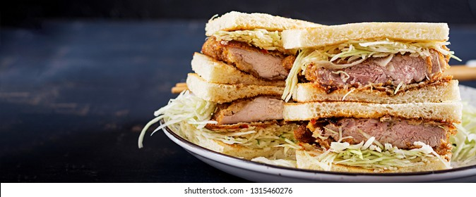 Katsu Sando - food trend japanese sandwich with breaded pork chop, cabbage and tonkatsu sauce. Japanese cuisine. Banner