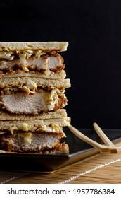 Katsu sandos japanese sandwich with chicken or pork chop, cabbage and tonkatsu