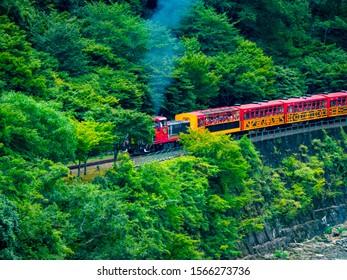 Katsura River and Sagano sightseeing railway trolley train. Arashiyama, Nishikyo-ku, Kyoto-shi, Kyoto
