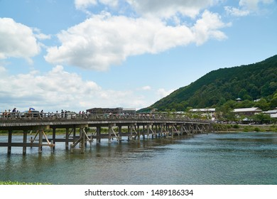 Katsura river,Arashiyama,Kyoto,Japan - July 7,2019 : Bridge over Katsura river at Arashiyama with some people