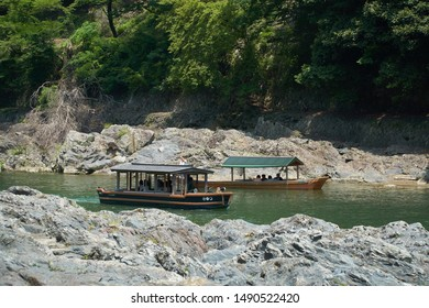 Katsura River,Kyoto,Japan - July 7,2019 : Tourists on the boats in the Katsura river