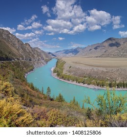 Katun River in the Altay Mountains, Travels in Russia. Scenic summer view. Beautiful sky and amazing water color.