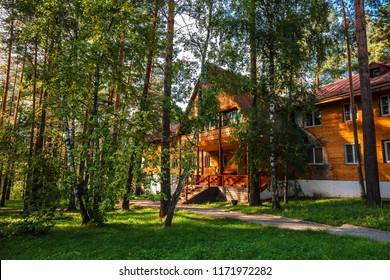 Katun tourist base, Katun River, Chemalsky district, Gorny Altai, South Siberia, Russia-August 25, 2018: residential buildings for vacationers in the forest