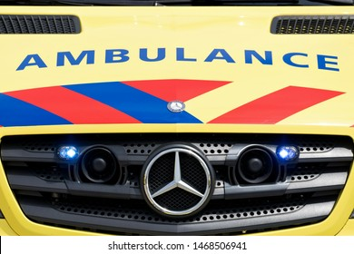 KATWIJK AAN ZEE, THE NETHERLANDS - JULY 6, 2019: Dutch ambulance Mercedes-Benz Sprinter with active blue emergency lighting