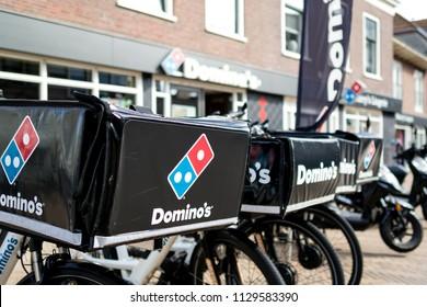 KATWIJK AAN ZEE, THE NETHERLANDS - June 18, 2018: Delivery bikes of Domino's restaurant. Domino's is an American pizza restaurant chain founded in 1960.