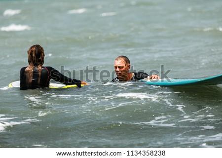 Katya And Vlad Surf The Morning