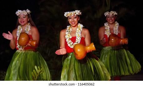 KAUAI, HAWAII - AUGUST 11: Aloha festival. Attractive young women in traditional dress perform Hawaiian dance on August 11, 2012 in Lihue, Kauai.