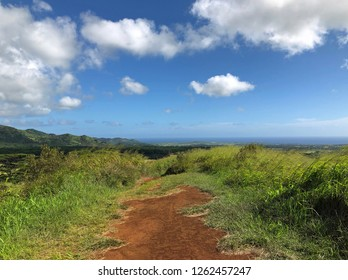 Kauai, Hawaii: country road runs through a mountain valley on a beautiful day