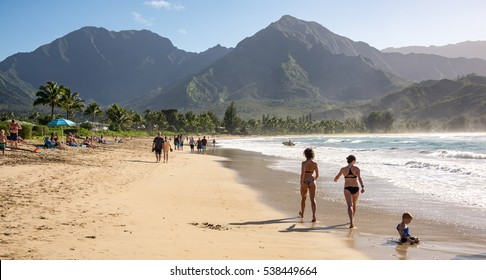 Kauai, Hawaii February 11, 2016 - People enjoying the sun & views on the beach at Hanalei Bay on the north shore of the small island of Kauai, Hawaii
